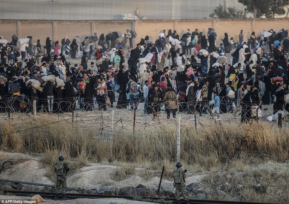 2998626A00000578-0-ISIS_terrorists_stopped_the_group_of_refugees_just_yards_from_th-a-26_1434225503619
